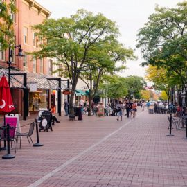 Church Street in Burlington, Vermont on a summer day - cobblestone pedestrian mall with businesses, customers and trees