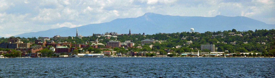 Viiew of Burlington, Vermont with buildings, mountains and water