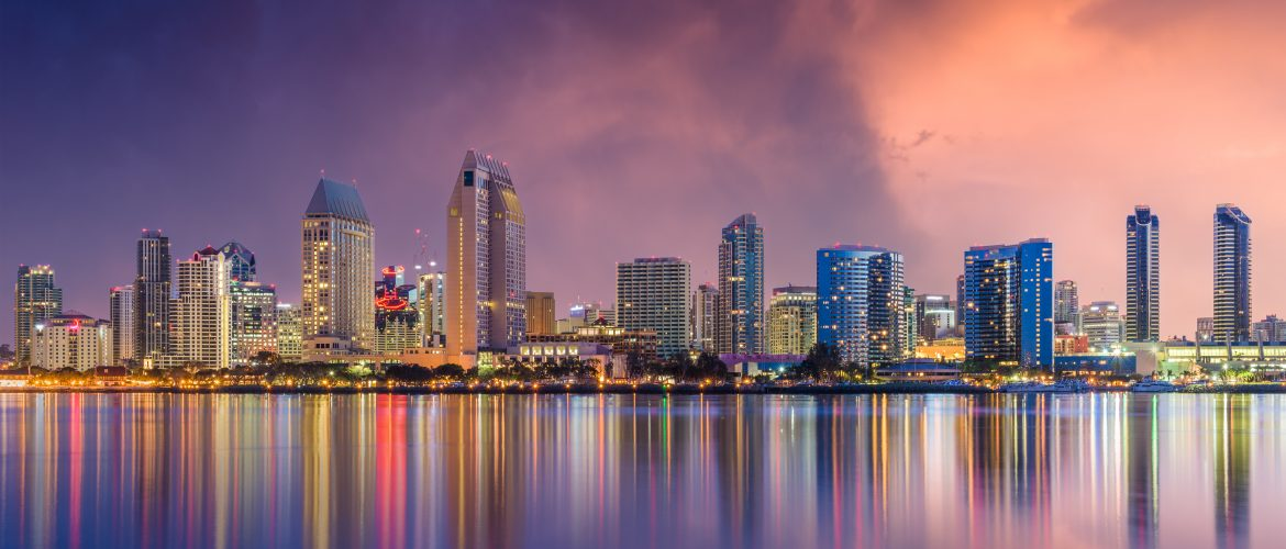View of buildings in San Diego, California at night from the water